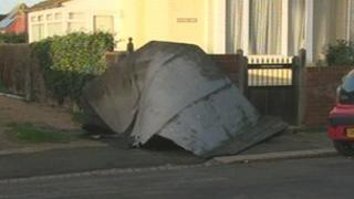 Part of the roof blown from a block of flats in Bexhill