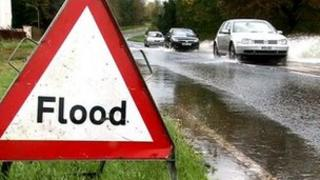 Flood sign on flooded road