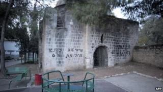 "Slogans reading: ""A good Arab is a dead Arab"" and ""price tag"" are spray-painted on the exterior walls of a mosque in central Jerusalem (14 December 2011)"