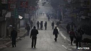 Nepalese police personnel are seen along the roads of Kathmandu during a countrywide strike against the Nepali government and police in Kathmandu December 19, 2011.