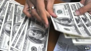 Counting $100 bills