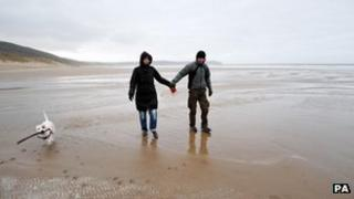 A couple on the beach at Woolacombe, north Devon, on 25 December