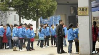 Striking workers at a factory in China belonging to Singapore electronics firm Hi-P