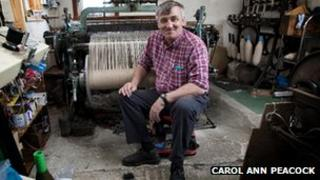 Donald John MacKay sitting in front of his loom