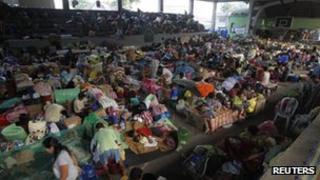 Survivors of Typhoon Washi at a temporary shelter
