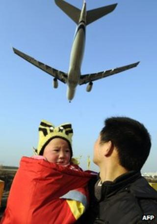 People and plane at Chinese airport