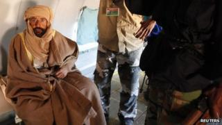 Saif al-Islam Gaddafi is pictured sitting in a plane in Zintan November 19, 2011
