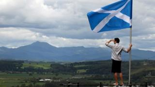 A man looks out over the Carse of Stirling from the base of the Wallace Monument in Stirling. Andrew Milligan/PA Wire