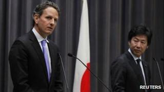 US Treasury Secretary Timothy Geithner, left, and his Japanese counterpart Jun Azumi in a joint press conference in Tokyo, Thursday, Jan. 12, 2012
