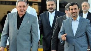 Cuban President Raul Castro (L) and Iranian President Mahmoud Ahmadinejad walk at Jose Marti airport, on 12 January before the latter's departure from Cuba