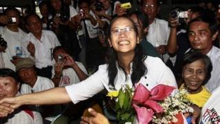 Nilar Thein, centre, an activist of the 88 Generation Students Group, shakes hands with one of her colleagues as she arrives at Rangoon airport after being released from Theyet prison Friday 13 January, 2012.