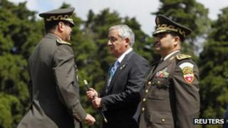 President Otto Perez Molina (c) during the ceremony appointing him as commander of the Army