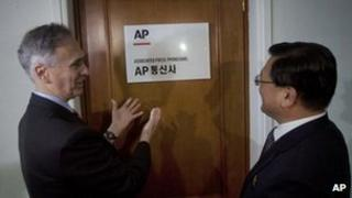 Associated Press President Tom Curley and Korean Central News Agency President Kim Pyong-ho outside the new AP office in Pyongyang, North Korea on 16 January 2012