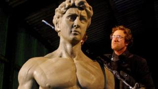 Nick Elphick with one of the statues