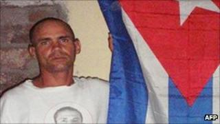 Wilman Villar beside a Cuban flag, picture distributed by opposition Patriotic Union of Cuba