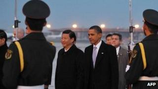 US President Barack Obama, right, greeted by Chinese Vice President Xi Jinping at Capital International Airport in Beijing on 16 November 2009