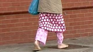 Woman wearing pyjamas outdoors