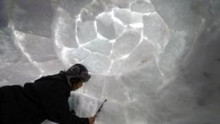 A man makes an Igloo