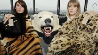 World Society for the Protection of Animals, campaign fund raisers, Margaret Balaskas, holding a Tiger skin coat and Anna Reaich, holding a Snow Leopard coat with the head and skin of a Polar Bear during a photocall