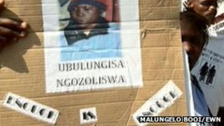 People hold up a poster of Zoliswa Nkonyana at a court hearing in September 2011 Copyright: Malungelo Booi/EWN
