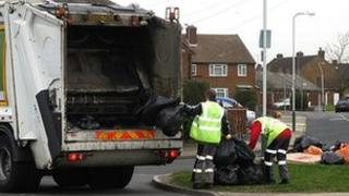 Bin men collecting rubbish in Rainham, Essex