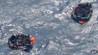 Aerial view of people in life-rafts after the ship sank on 2 February 2012