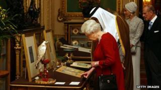 Queen Elizabeth II shows the Emir of Qatar, Sheikh Hamad bin Khalifa al-Thani, around exhibits from the Royal Collection