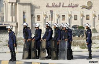 Riot police guard an entrance to the site of the now-demolished Pearl Roundabout (14 February 2012)