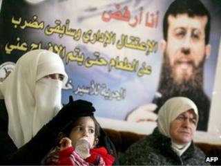 The wife, daughter and mother of Khader Adnan site in the family's home in the West Bank village of Arrabeh (21 February 2012)