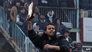 Half-burnt Koran held during protest outside Bagram Airbase