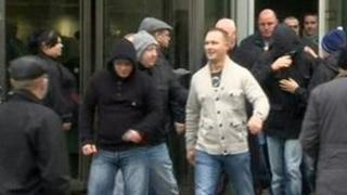 Some of the acquitted men and their supporters leaving court after the verdicts