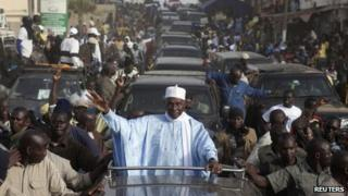 """Senegal""""s incumbent President Abdoulaye Wade attends an election campaign rally in the capital Dakar February 22, 2012."""