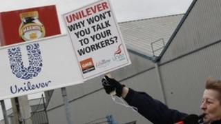"""A striking worker stands on a picket line outside Unilever's Marmite factory in Burton-Upon-Trent, central England, January 25, 2012. Workers at Unilever took part in 11 days of strike action over the consumer goods company""""s decision to close its final salary pension scheme"""