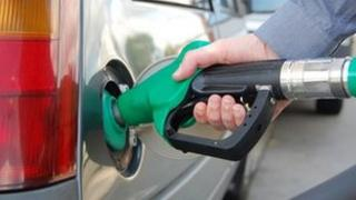 A man filling his car with petrol