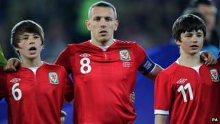 Craig Bellamy (centre) with Gary Speed's sons Ed and Tom during the International Friendly at Cardiff City Stadium, Cardiff