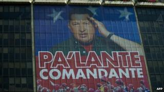 """Giant photograph of Hugo Chavez on the facade of the state oil company PDVSA, reading """"Onward, commander"""" - 29 February"""