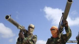 Members of al-Shabab hold their weapons in Somalia's capital, Mogadishu (Archive shot)