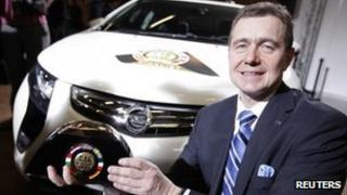 Karl-Friedrich Stracke, Opel's chief executive, poses with the Car of the Year 2012 award