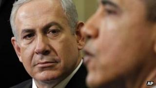 Barack Obama speaks and Benjamin Netanyahu listens on