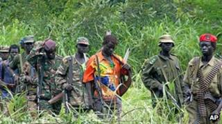File picture taken in 2006 of members of Uganda's Lord's Resistance Army as their leader Joseph Kony meets with a delegation of Ugandan officials and lawmakers and NGO representatives in DR Congo near the Sudanese border