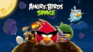 A promotional image for Angry Birds Space shows the popular bird characters resting on an asteroid wearing laser goggles!