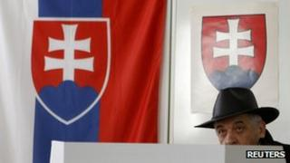 Man prepares to cast vote in Slovak poll