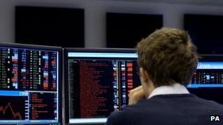 Trader watches share index