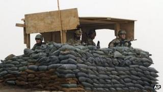 US and Afghan troops in a guard tower, Panjwai district, Kandahar province (11 March)