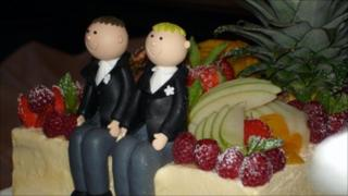 Two male figures in morning suits on a wedding cake. Copyright: Nick Lansley