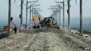 Work continues along a section of Hanyi High Speed Railway near Qianjiang in central China's Hubei province, 12 March 2012
