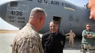 Leon Panetta (centre) after arriving at Camp Bastion (14 March 2012)
