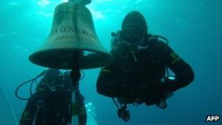 Divers with the bell of the sunken Costa Concordia, January 2012