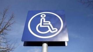 Sign a0bove disabled parking bay