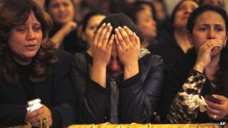 Egyptian Christian women mourn the death of Pope Shenouda III inside the cathedral of Cairo on 17 March 2012